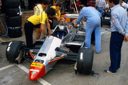 Mechanics work on the Ferrari 126C2 of Didier Pironi in the pits