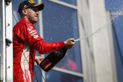 Podium: second place Sebastian Vettel, Ferrari celebrates on the podium with champagne