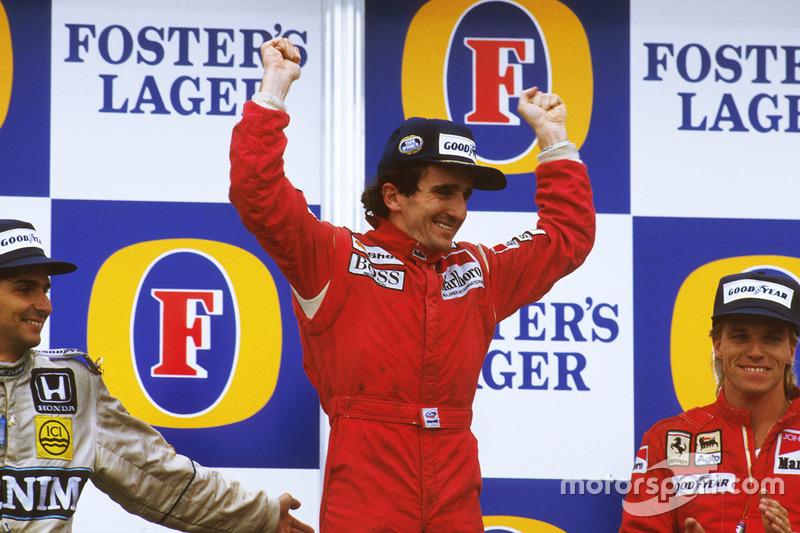 Podium: race winner Alain Prost, McLaren TAG Porsche, second place Nelson Piquet, Williams Honda, third place Stefan Johansson, Ferrari