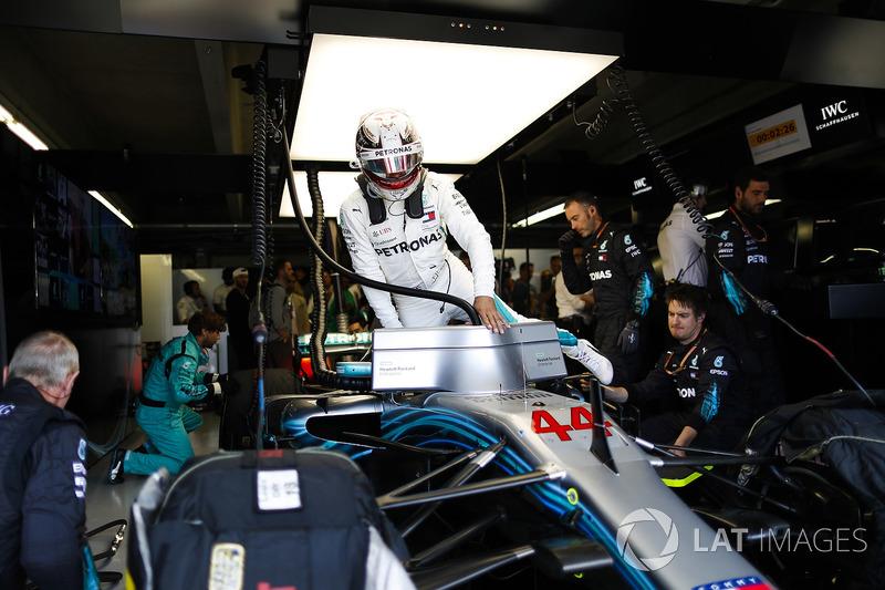 Lewis Hamilton, Mercedes AMG F1 W09, climbs into his car in the garage