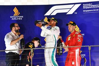 Max Verstappen, Red Bull Racing, Lewis Hamilton, Mercedes AMG F1 and Sebastian Vettel, Ferrari celebrate on the podium with the champagne