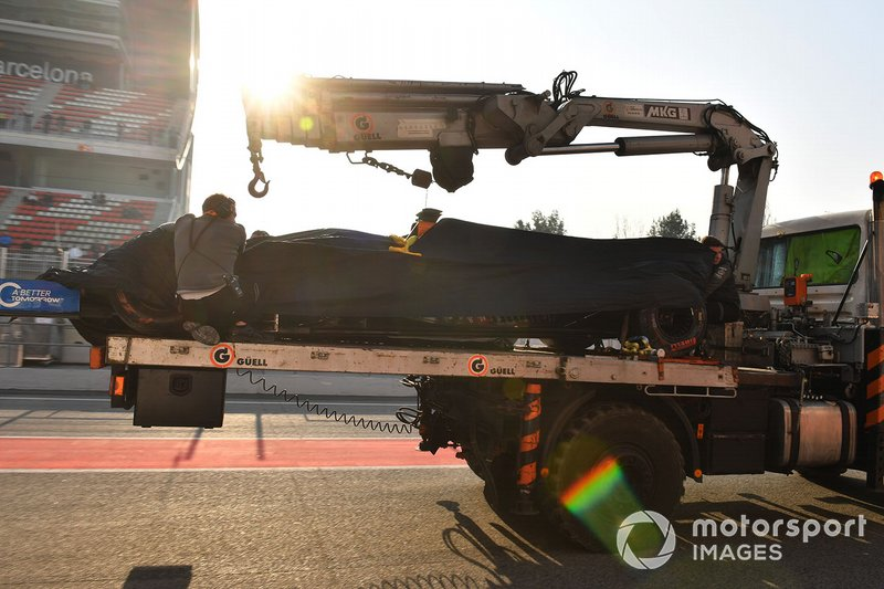The car of Lando Norris, McLaren is recovered to the pits