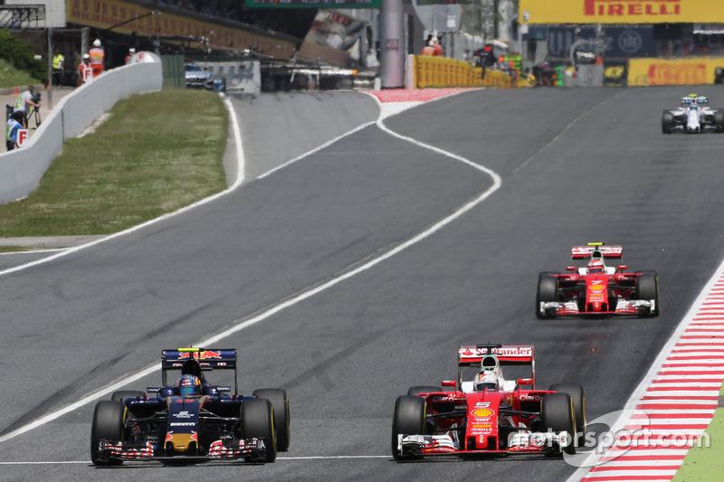 Carlos Sainz, Scuderia Toro Rosso und Sebastian Vettel, Scuderia Ferrari