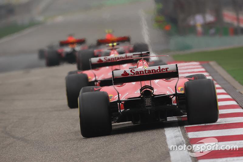 Max Verstappen, Red Bull Racing RB13, leads Kimi Raikkonen, Ferrari SF70H, and Sebastian Vettel, Fer