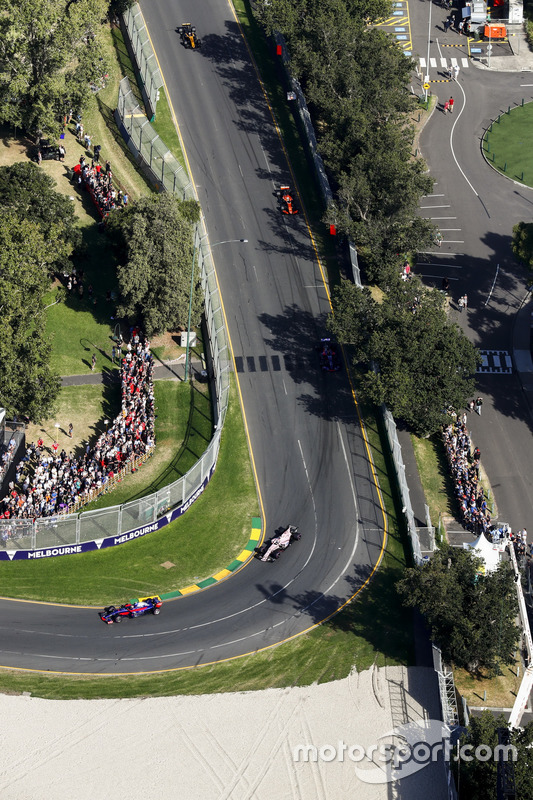 Carlos Sainz Jr., Scuderia Toro Rosso STR12, leads Sergio Perez, Force India VJM10