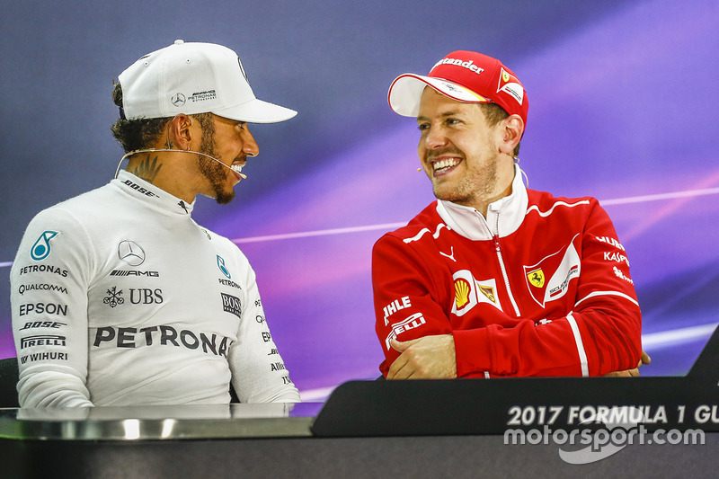 Post-race press conference: race winner Sebastian Vettel, Ferrari, second place Lewis Hamilton, Merc