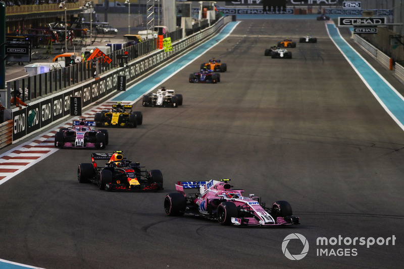 Esteban Ocon, Racing Point Force India VJM11, leads Max Verstappen, Red Bull Racing RB14, eEsteban Ocon, Racing Point Force India VJM11, Carlos Sainz Jr., Renault Sport F1 Team R.S. 18, and Marcus Ericsson, Sauber C37