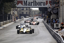 Rene Arnoux, Renault RE30B leads Riccardo Patrese, Brabham BT49D-Ford Cosworth, Bruno Giacomelli, Alfa Romeo 182, Alain Prost, Renault RE30B and Didier Pironi, Ferrari 126C2