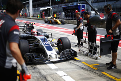 Kevin Magnussen, Haas F1 Team VF-17, stops in his pit garage as Nico Hulkenberg, Renault Sport F1 Team RS17, passes by