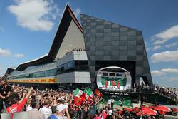 Lewis Hamilton, Mercedes-AMG F1, Claudio Albertini, Ferrari Engineer, Sebastian Vettel, Ferrari and Kimi Raikkonen, Ferrari celebrate on the podium