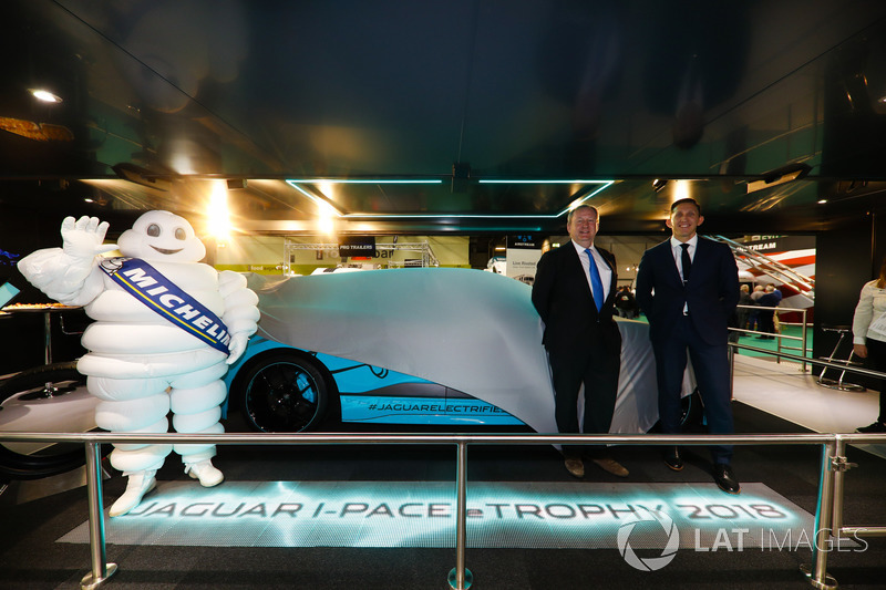 The Jaguar I-Pace eTrophy is launched, James Barclay and Pascal Couasnon stand alongside a Michelin man