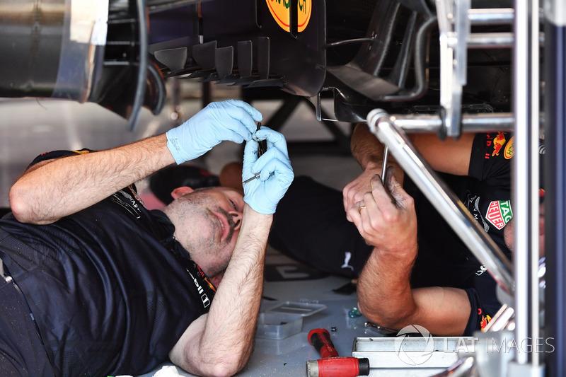 Red Bull Racing mechanics work on Red Bull Racing RB14