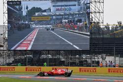 Sebastian Vettel, Ferrari SF70H on lap 2 and Lewis Hamilton, Mercedes-Benz F1 W08  in pit lane on the screen