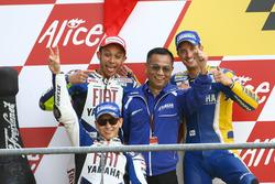 Podium: Race winner Valentino Rossi, Yamaha; second place Jorge Lorenzo, Yamaha; third place Colin E