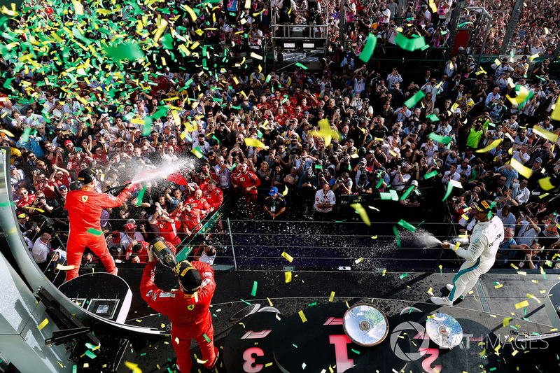 Race winner Sebastian Vettel, Ferrari, second place Lewis Hamilton, Mercedes AMG F1, third place, Kimi Raikkonen, Ferrari, celebrate on the podium as confetti rains down