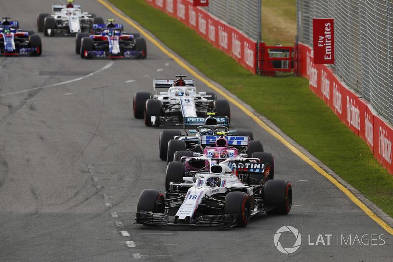 Lance Stroll, Williams FW41 Mercedes, leads Esteban Ocon, Force India VJM11 Mercedes, and Valtteri B
