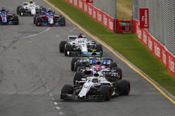 Lance Stroll, Williams FW41 Mercedes, leads Esteban Ocon, Force India VJM11 Mercedes, and Valtteri Bottas, Mercedes AMG F1 W09