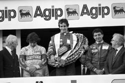 Podium: race winner Alain Prost, McLaren, second place Michele Alboreto, Ferrari, third place Nelson Piquet, Brabham