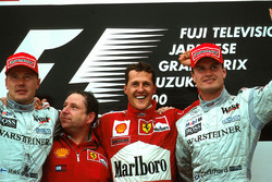 Podium: Mika Hakkinen second , Jean Todt, race winner Michael Schumacher, Ferrari F1 2000 and David Coulthard third