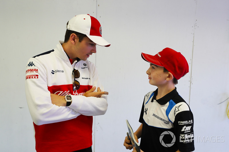 Charles Leclerc, Sauber, talks to a grid kid
