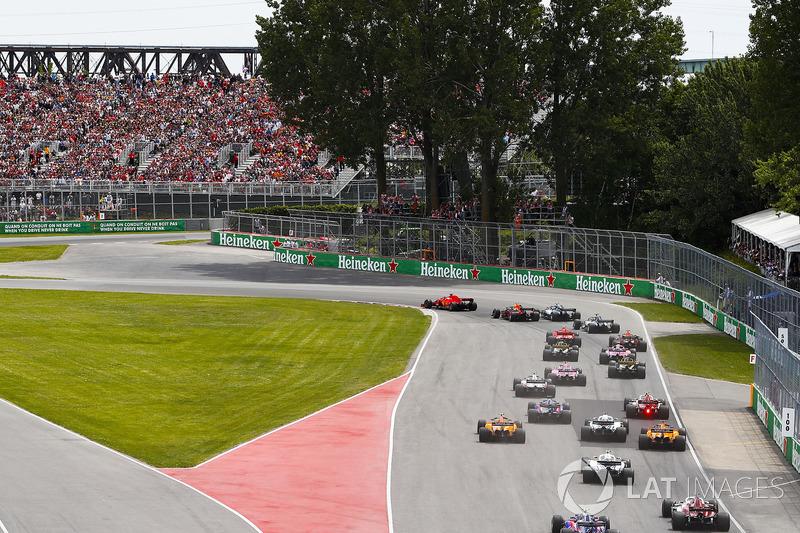 Sebastian Vettel, Ferrari SF71H, leads Max Verstappen, Red Bull Racing RB14, Valtteri Bottas, Merced