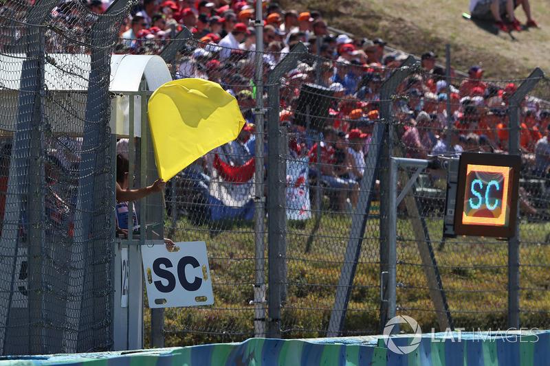 Marshal waves a Yellow flag