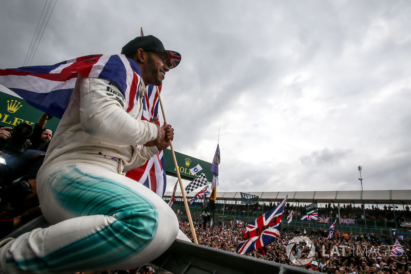 Race winner Lewis Hamilton, Mercedes AMG F1 celebrates with the fans and the union Jack flag