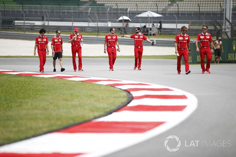 Sebastian Vettel, Ferrari, walks the track, colleagues