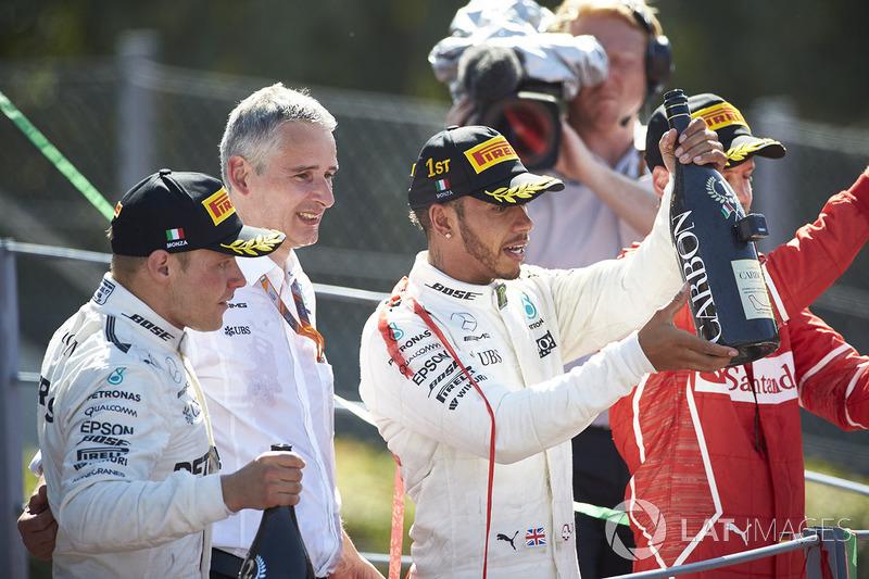 Second place Valtteri Bottas, Mercedes AMG F1, Race winner Third place Lewis Hamilton, Mercedes AMG F1 Sebastian Vettel, Ferrari, their Champagne