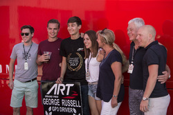 George Russell, ART Grand Prix celebrates with his family, friends