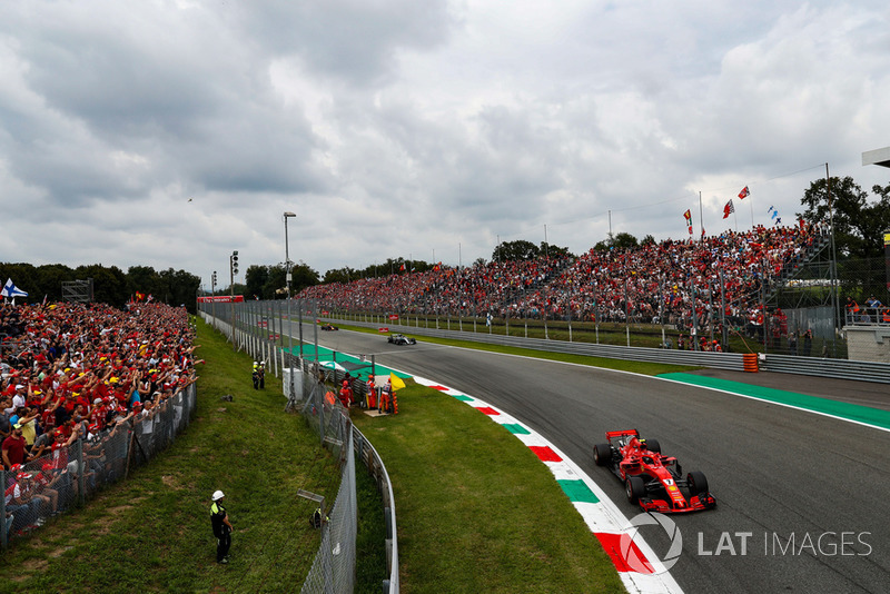Kimi Raikkonen, Ferrari SF71H, leads Lewis Hamilton, Mercedes AMG F1 W09, and Max Verstappen, Red Bull Racing RB14