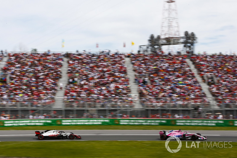 Sergio Perez, Force India VJM11, leads Kevin Magnussen, Haas F1 Team VF-18