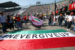Fans with 'Never Give Up' Mexican banner and flag of Sergio Perez, Sahara Force India and