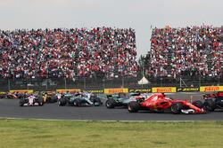 Sebastian Vettel, Ferrari SF70H and Lewis Hamilton, Mercedes-Benz F1 W08  clash at the start of the race