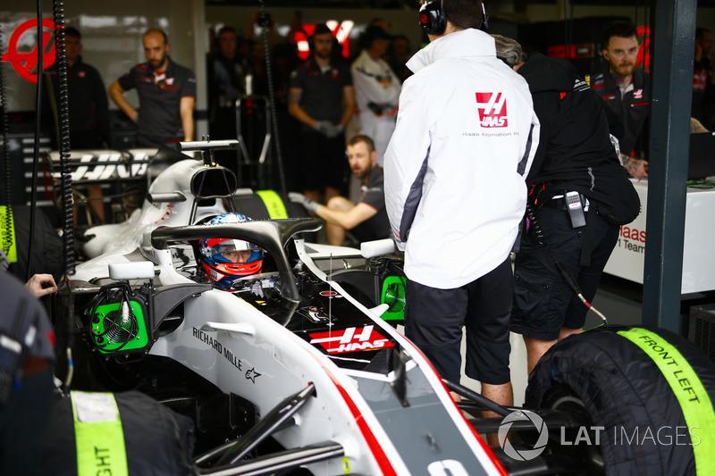 Romain Grosjean, Haas F1 Team VF-18 Ferrari, in the garage