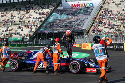 Marshals recover the car of Pierre Gasly, Scuderia Toro Rosso STR12 after stopping on track in FP3