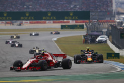 Kimi Raikkonen, Ferrari SF71H, leads Max Verstappen, Red Bull Racing RB14