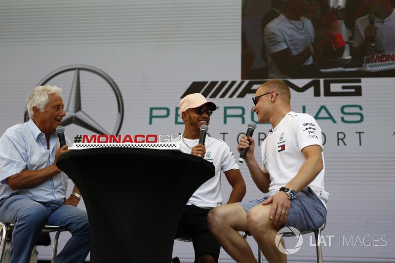 Lewis Hamilton, Mercedes-AMG F1 and Valtteri Bottas, Mercedes-AMG F1 on stage with Bob Constanduros