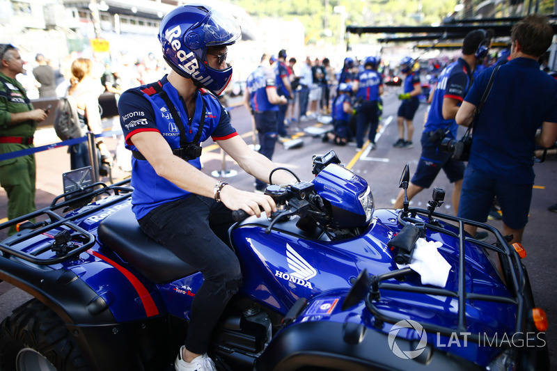Pierre Gasly, Toro Rosso, sits on a Honda quad bike