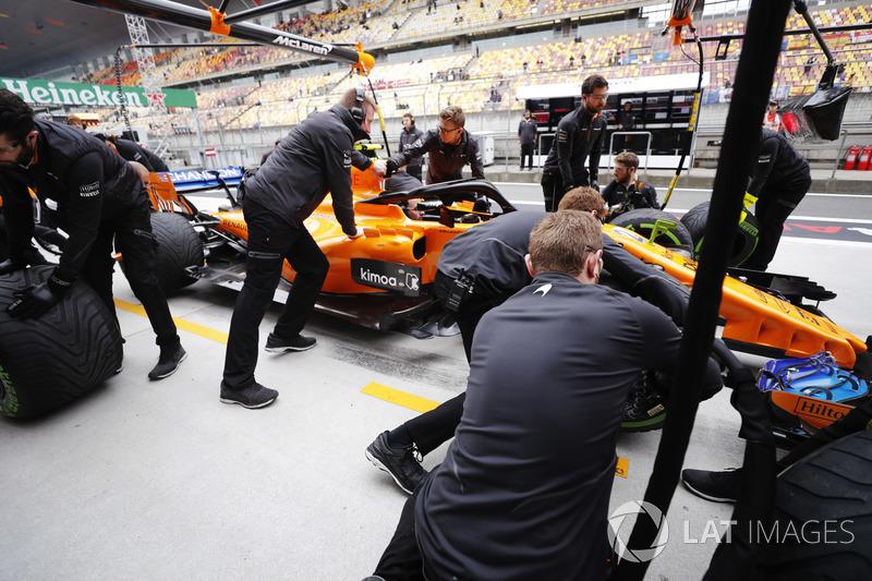 The McLaren team conduct practice pit stops