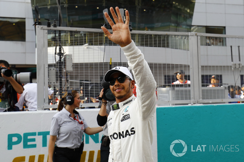 Pole winner Lewis Hamilton, Mercedes AMG F1, waves to fans