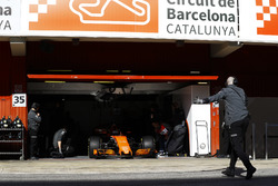 The McLaren garage door is raised as Fernando Alonso, McLaren MCL32 enters the pit lane
