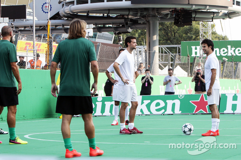 Jolyon Palmer, Renault Sport F1 Team and Sergio Perez, Sahara Force India F1 at the charity 5-a-side football match