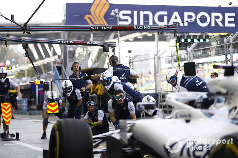 Lance Stroll, Williams FW41, approaches his pit area