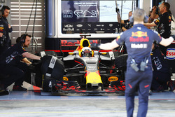 A Red Bull employee signals to Daniel Ricciardo, Red Bull Racing, as he prepares to exit his garage