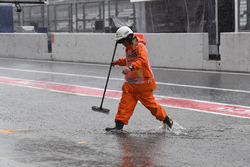 Marshal in flooded pit lane