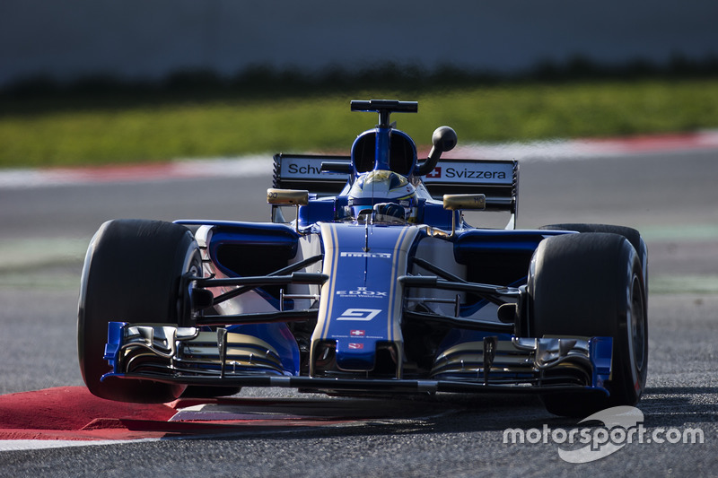 Marcus Ericsson, Sauber C36, lifts a wheel over a kerb