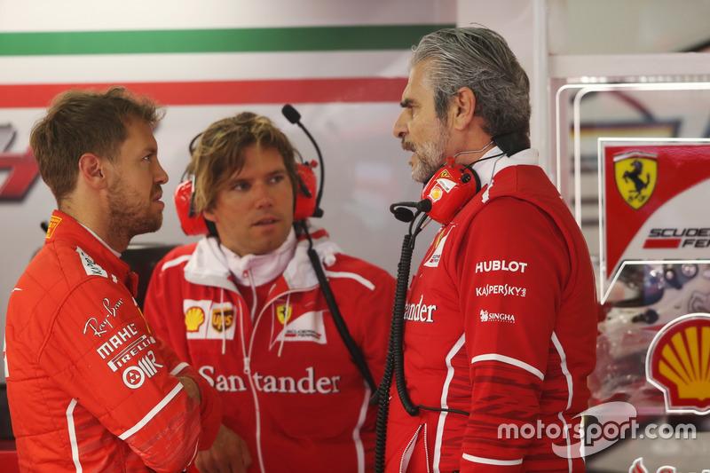 Sebastian Vettel, Ferrari, talks to Maurizio Arrivabene, Team Principal, Ferrari