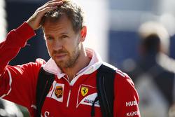 Sebastian Vettel, Ferrari, arrives in the paddock