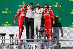 Second place Sebastian Vettel, Ferrari, James Allison, Mercedes Technical Director, race winner Lewis Hamilton, Mercedes AMG F1 and third place Kimi Raikkonen, Ferrari celebrate on the podium